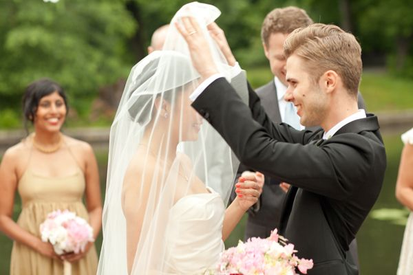 Groom Lifting Brides Veil