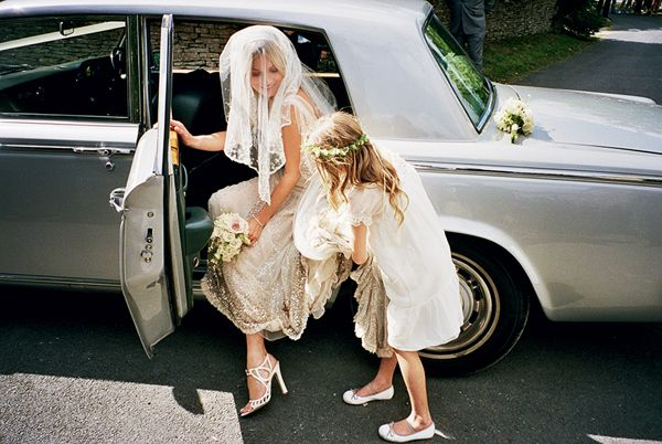 Helping Mom Kate Moss Into Car