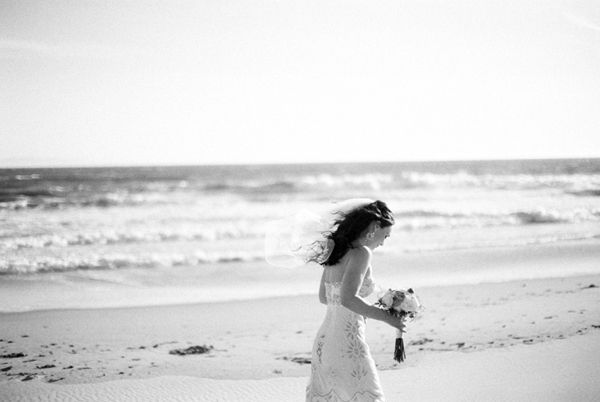 bride-walking-on-beach