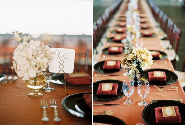 airplane-hanger-reception-tables-centerpiece-flowers-table-numbers-coral-beige