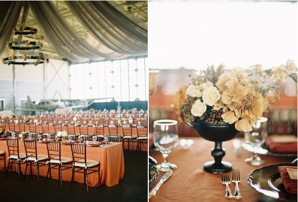 airplane-hanger-wedding-reception-venue-centerpiece-decor-flowers-coral-beige-tables