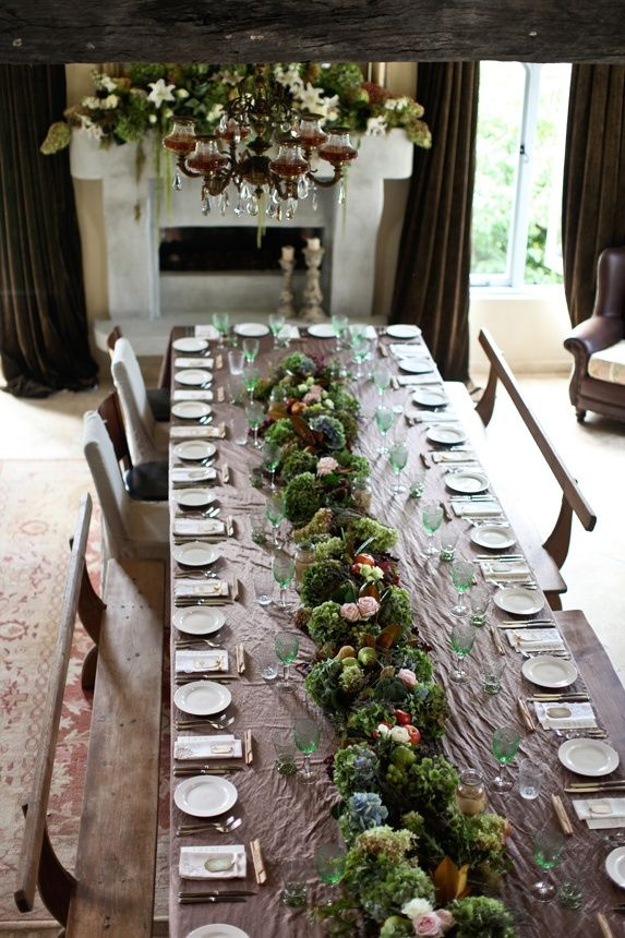 lovely moss garland reception tables