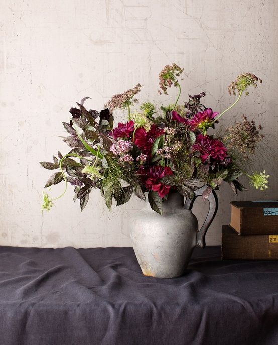 arranging flowers with herbs