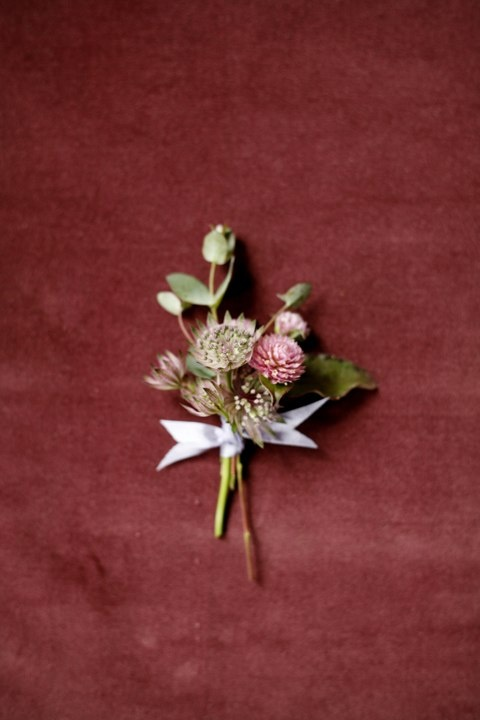 boutonnieres red green brown