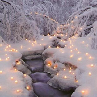 candles in snow walkway