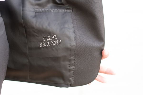 engraves initial white coat stitching