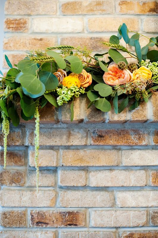 flower garland brick wall