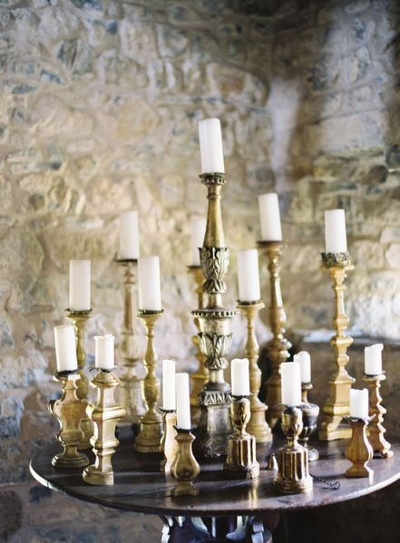 gold chandeliers white candles