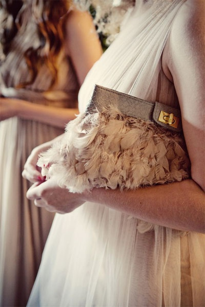 light pink feather clutch