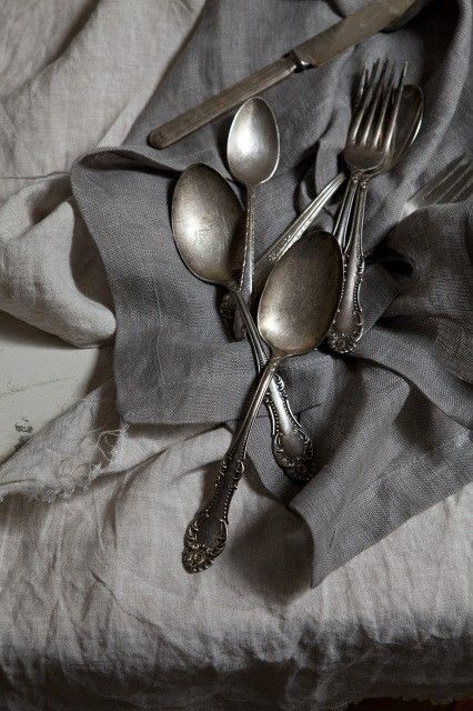 linen and tarnished silver