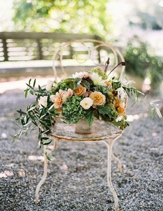 lush orange green wedding centerpiece