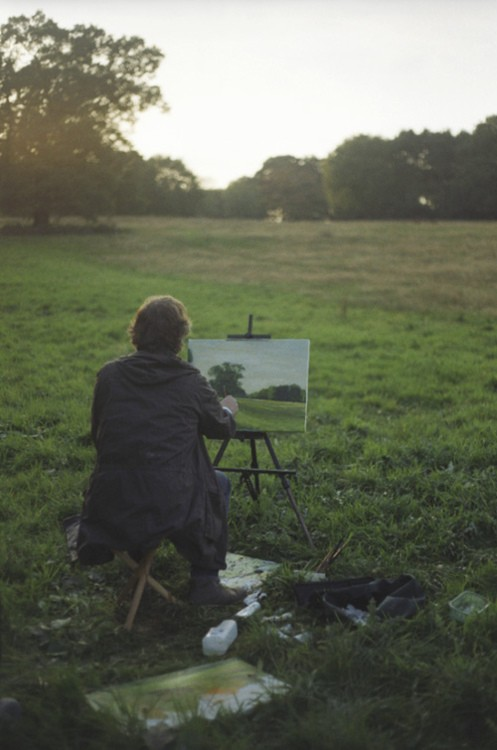 painting in a field
