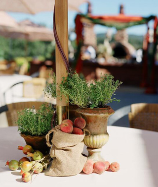 peach brown bag wedding centerpiece