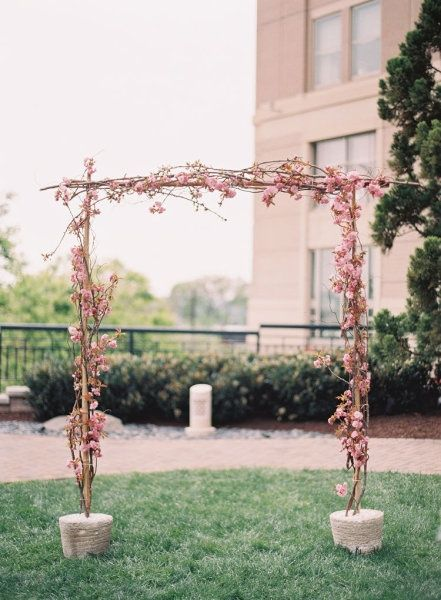pink flower ceremony arch
