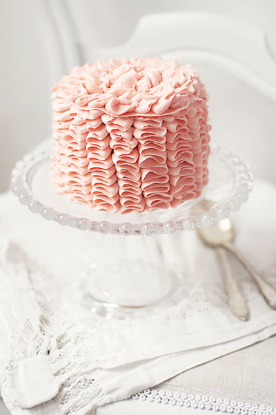 pink ruffled icing wedding cake small elegant