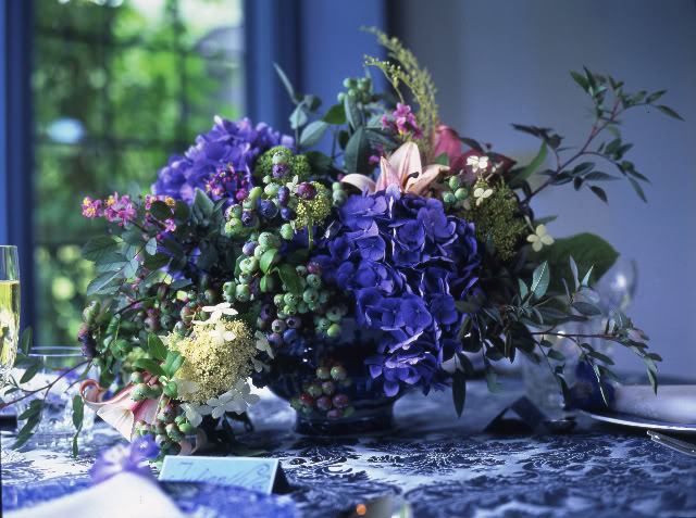 purple fruit and flower centerpiece