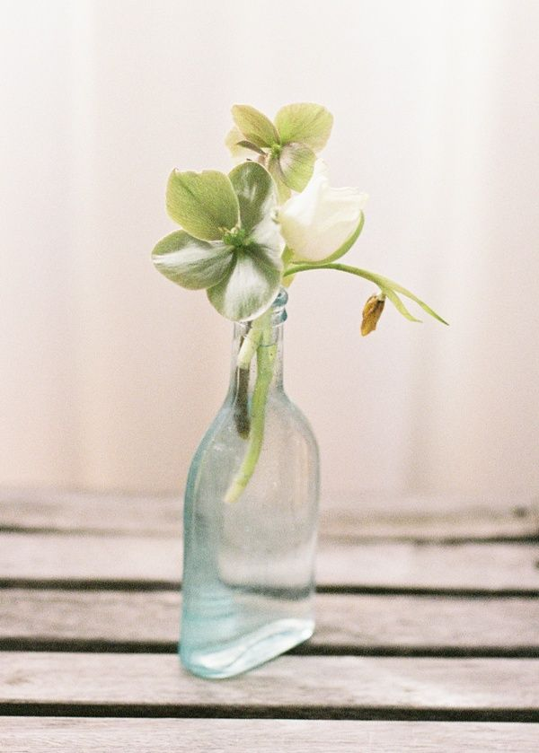 simple glass bottle wedding reception centerpiece
