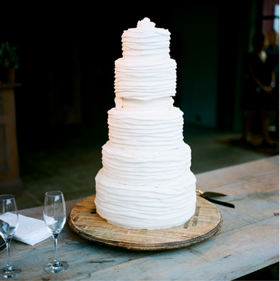 tall white ruffle wedding cake