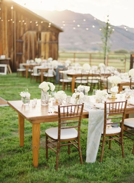 white flower reception tables mountains
