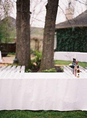 backyard-cocktail-hour-bar-wine-trees-white-linens