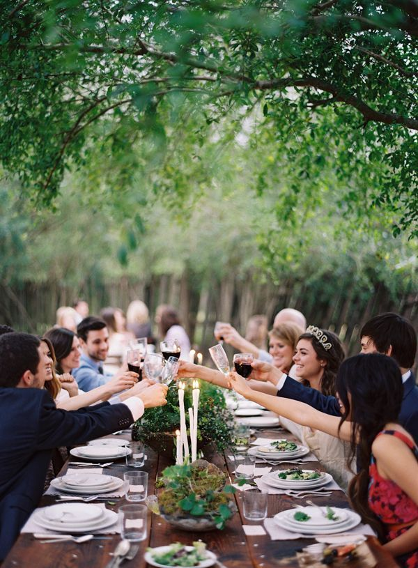 cheers-toast-wedding-reception-wine-under-trees-backyard-outdoor-dinner-friends-alfresco