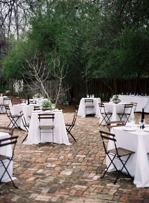 dad-made-reclaimed-brick-patio-terrace-for-backyard-wedding-reception-bistro-tables-cafe-chairs