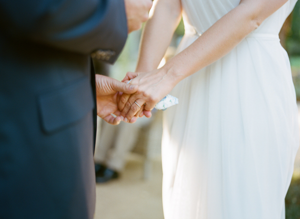 hand-holding-during-wedding-vows