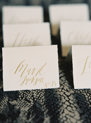 elegant-gold-calligraphy-escort-cards