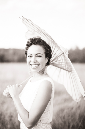nancy-neil-bride-parasol-field