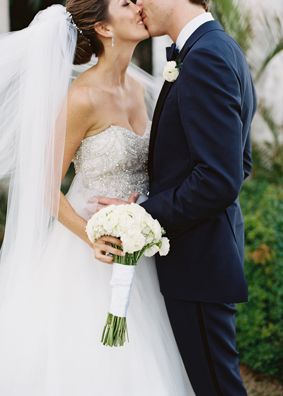 eric-kelley-wedding-BadgleyMishka-dress-kiss-white-bouquet