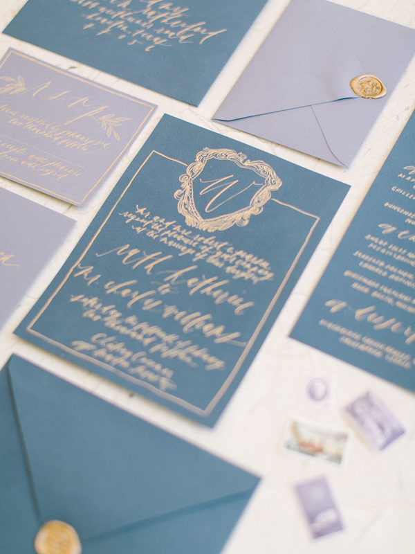 gold-blue-calligraphy-wedding-invitations