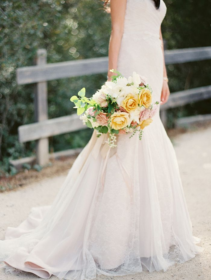 23-mermaid-wedding-gown-yellow-bouquet