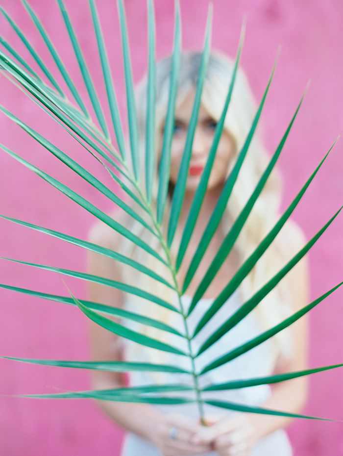 12-palm-leaf-pink-wall-white-swimsuit