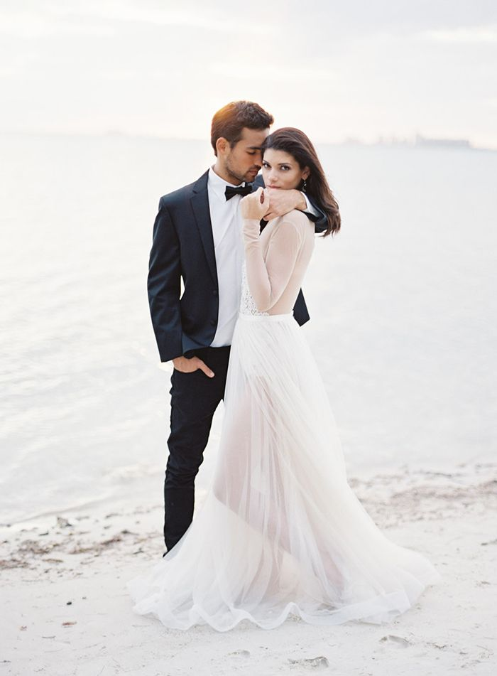 13-longsleeve-wedding-gown-beach-feather-and-stone