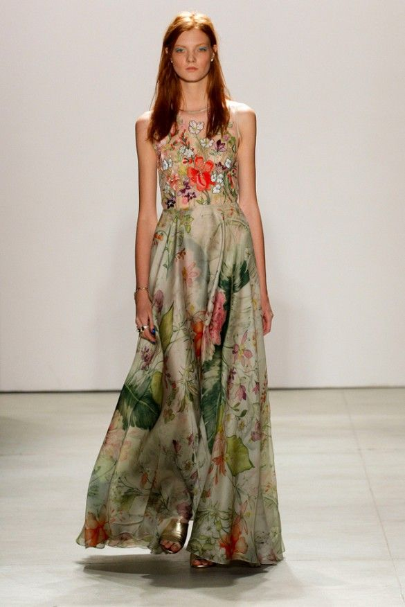 Jenny Packham The exuberant bride will make a splash in mixed florals with pops of color