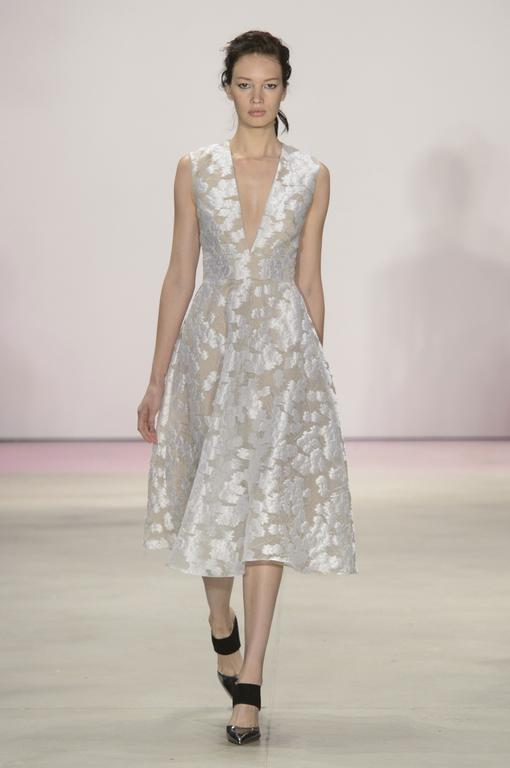 Lela Rose An a-line tea-length deep-v angular frock in a dimensional floral print can work for a plethora of bridal activities