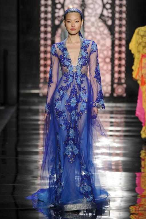 Reem Acra Sheer blue chiffon and floral is an attention-grabbing, unexpected, and ethereal look for the rehearsal dinner