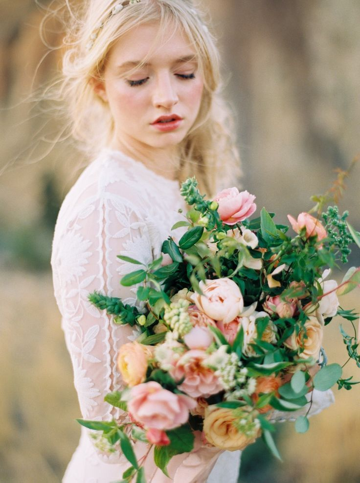 A bridal bouquet with punchy spring sherbet tones created by Tinge Floral  at the Erich McVey Workshop.