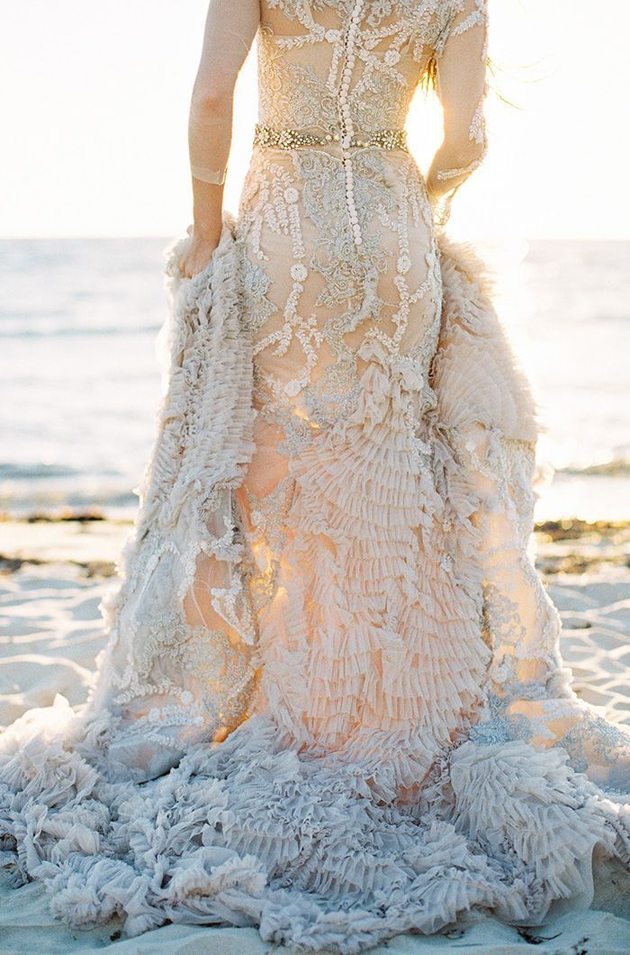 Seaside Bride  A Pleated Gown reflects the opalescent lavender tones whilst adding character and texture.