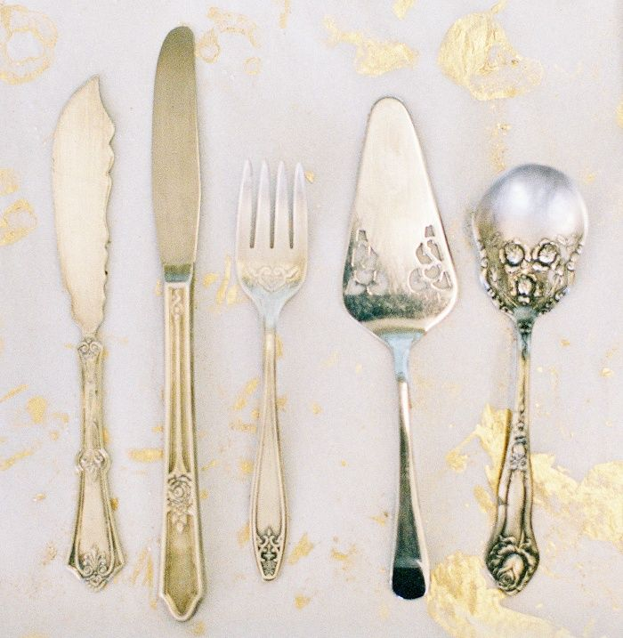 Vintage silver serving pieces provide a warm residential feel and an heirloom-quality tone.