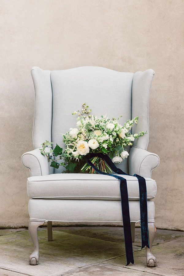 Lindsay Coletta Floral A chair with stature is a stately backdrop to photograph bouquets, while also adding a background of serenity blue.