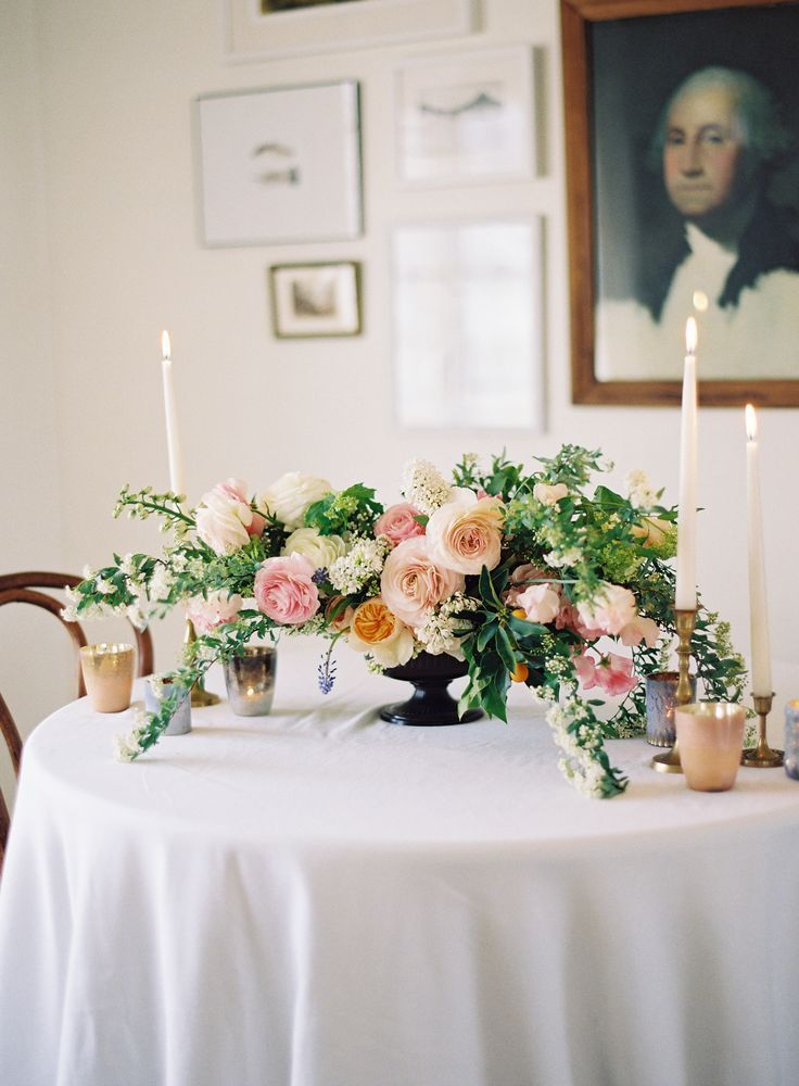 Tingle Floral Peachy tones and opalescent accents with elegant tapers hit all the right notes for a spring tablescape.