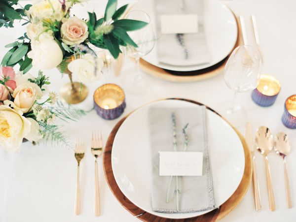 Elegant Hellebore Wedding Ideas A tablescape with modern earthy wood chargers, peach and lavender hues, and brass accents is relaxed and unique.