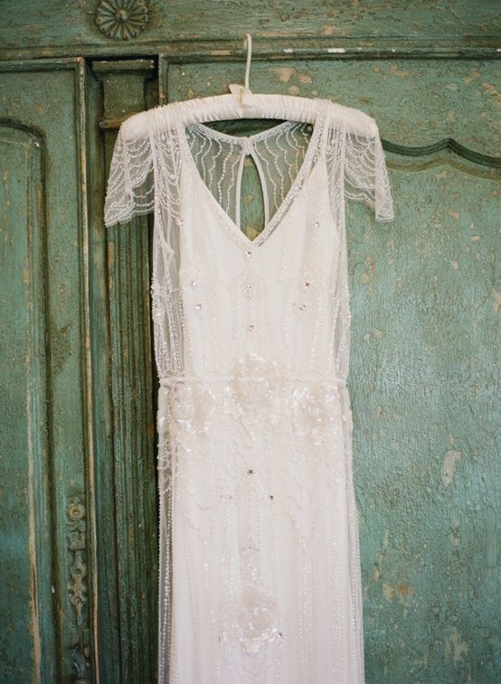Bridal gown on fabric hanger.