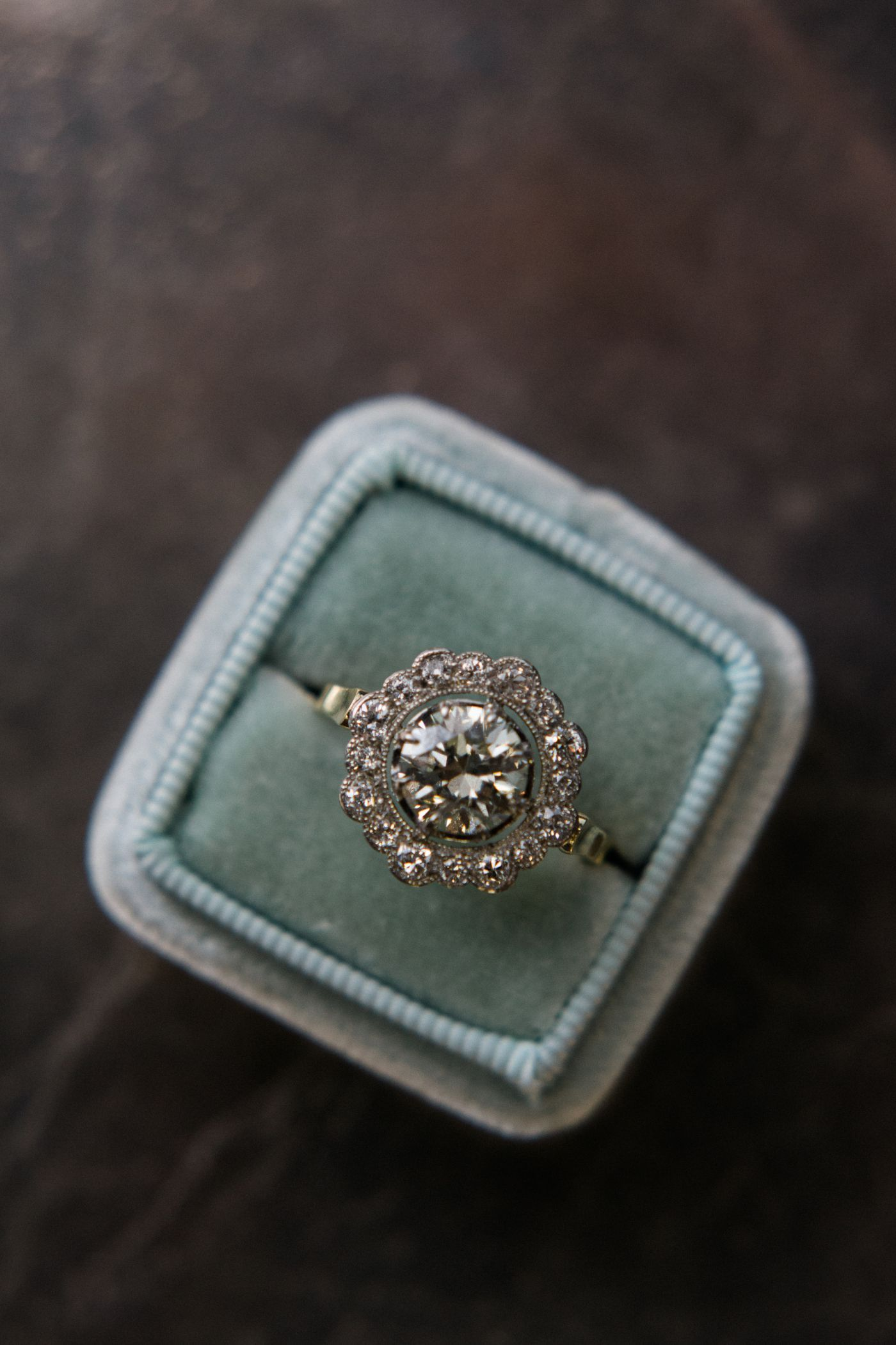 Scarborough, Edwardian, 1.59ct Transitional Brilliant cut diamond, halo of diamonds, yellow gold shank, Sold.