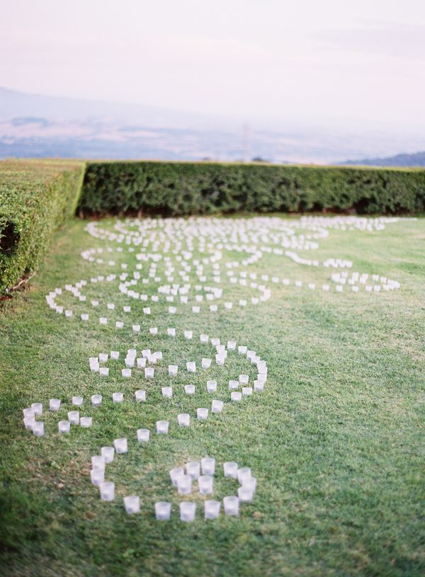 ITALY: Elegant Tuscan Wedding | Votives swirled around the lawn during dinner and dancing, and the disco was ignited with a confetti bomb.