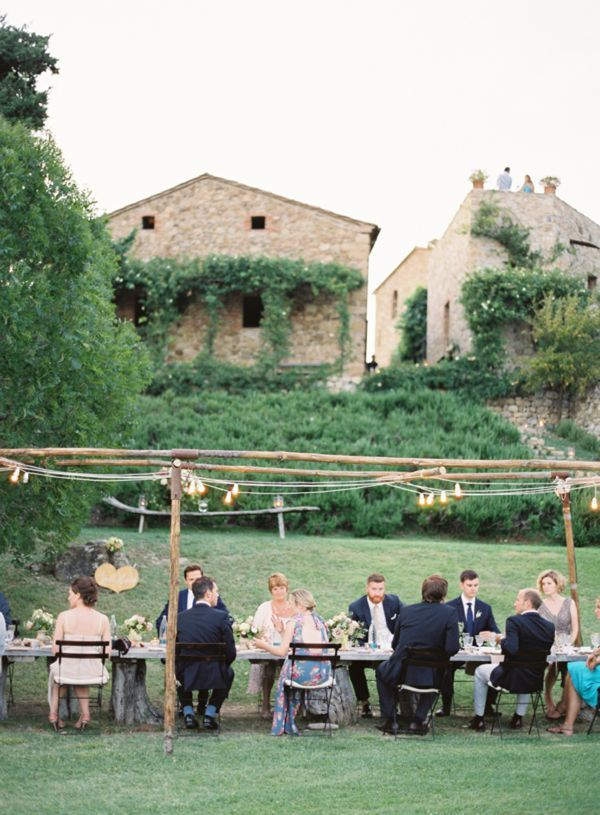 ITALY: Elegant Tuscan Wedding | Guests were welcomed to the ceremony with cocktails invented by a mixologist friend, and then enjoyed a long table dinner at this elegant, modern wedding hosted at Castello di Vicarello.