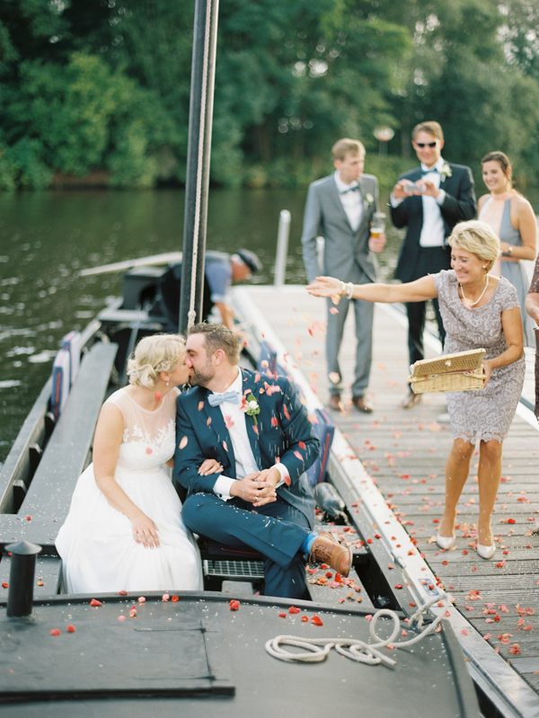 GERMANY: Delicate and Romantic Wedding | The couple made a grand entrance to their reception by boat, amidst idyllic country scenery.