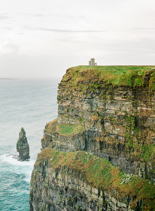 IRELAND: Breathtaking Engagement | The dramatic cliffs in Ireland look majestic and mysterious.