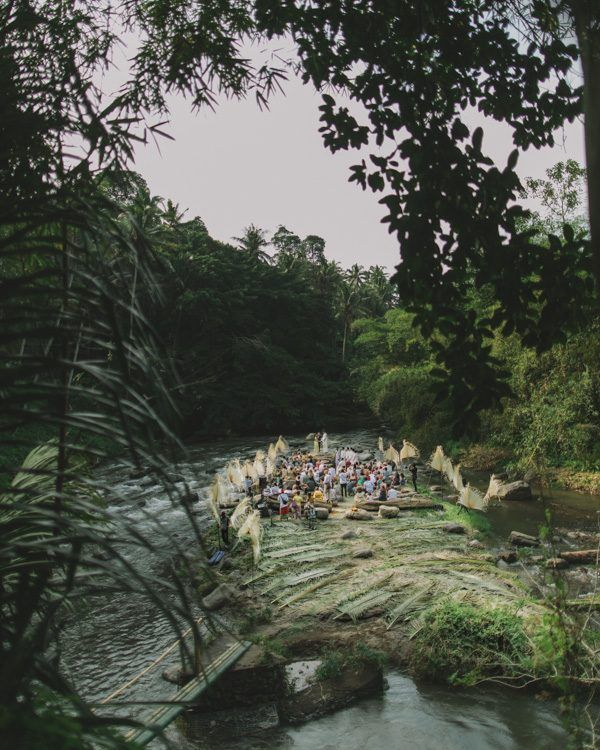 BALI: Destination Cultural Wedding | This couple's ceremony took place in the middle of a river. Afterwards the couple took portraits in a nearby rice paddy.